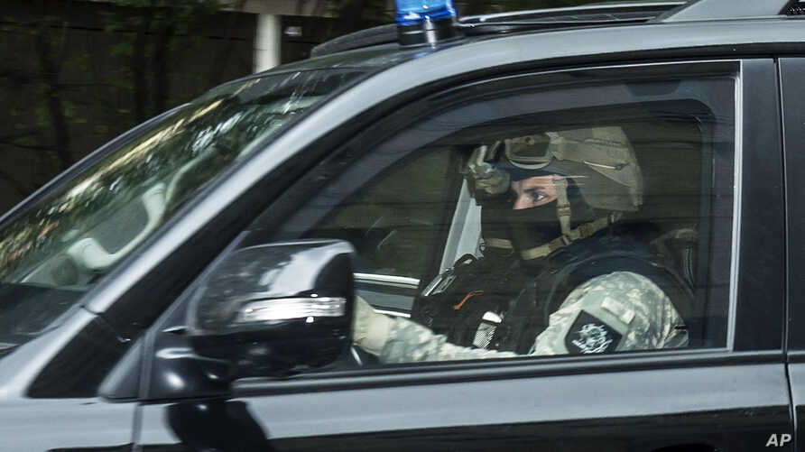 A police car leaves the district court in Dresden, eastern Germany, Oct. 10, 2016, after Jaber Albakr, 22, was arrested in the eastern city of Leipzig, following a nearly two-day manhunt.