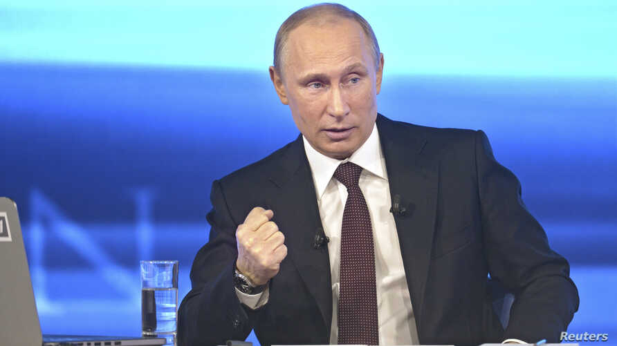 Russian President Vladimir Putin takes part in a live broadcast nationwide phone-in, in Moscow, Apr. 17, 2014.