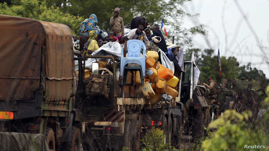 Muslims fleeing sectarian violence are on top of a truck with their belongings -- on the road between Bangui and Sibut -- on a convoy being escorted by French peacekeepers to the south eastern town of Bambari, Central African Republic, April 20, 2014