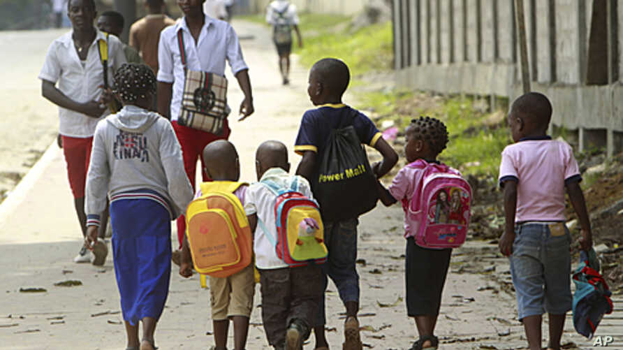 Students walk along a street after classes in Bata. The African Nations Cup is being co-hosted by Equatorial Guinea and Gabon from January 21 to February 12, January 19, 2012.