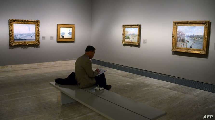 FILE - A man attends the opening of the first monographic exhibition in Spain on Danish-French impressionist painter Camille Pissarro at the Thyssen-Bornemisza museum in Madrid, June 3, 2013.