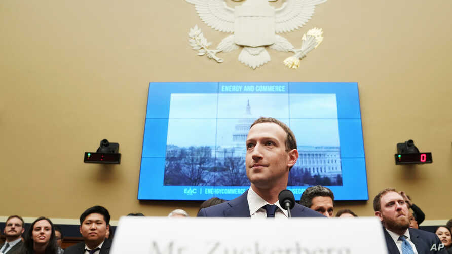 Facebook CEO Mark Zuckerberg arrives to testify before a House Energy and Commerce hearing on Capitol Hill in Washington, Wednesday, April 11, 2018, about the use of Facebook data to target American voters in the 2016 election and data privacy.