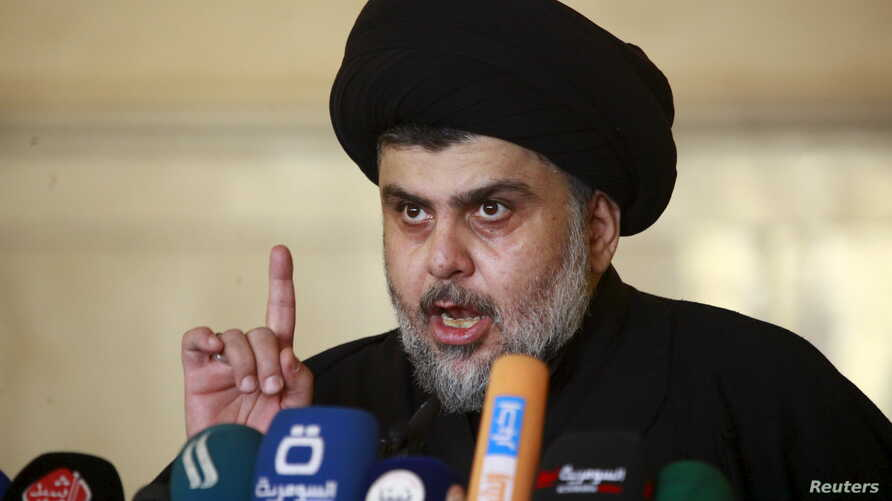 FILE - Iraqi Shi'ite radical leader Muqtada al-Sadr delivers a sermon to worshippers during Friday prayers at the Kufa mosque near Najaf, Dec. 11, 2015.