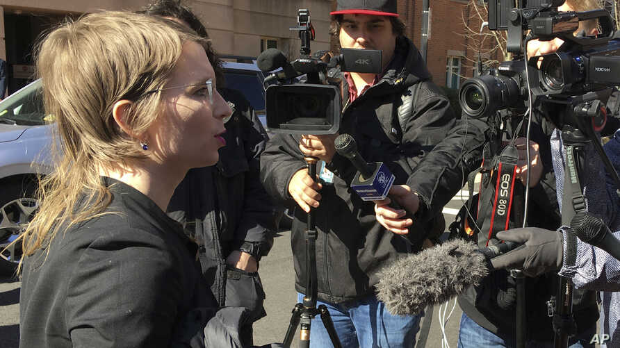 Chelsea Manning addresses the media outside federal court in Alexandria, Va. The former Army intelligence analyst was ordered to jail Friday, March 8, 2019, for refusing to testify to a Virginia grand jury investigating Wikileaks.