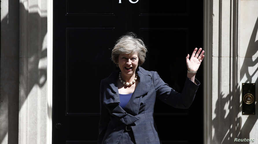 Wednesday, waves as she leaves after a cabinet meeting at number 10 Downing Street in central London, Britain on July 12, 2016. (Reuters)