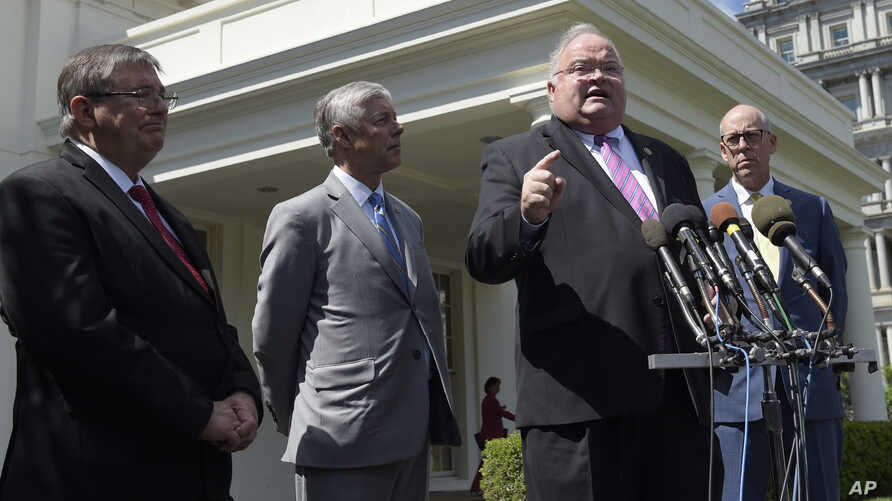 Rep. Billy Long, second from right, speaks to reporters outside the White House in Washington, May 3, 2017. From left are, Rep. Michael Burgess, Rep. Fred Upton, R-Mich., and Rep. Greg Walden.