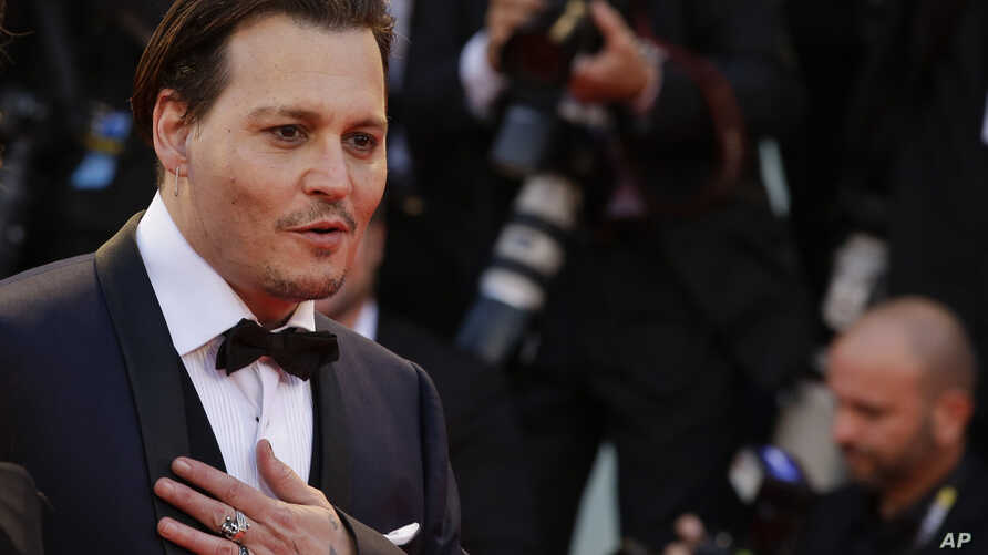 """Actor Johnny Depp poses for photographers upon arrival at the premiere of the film """"Black Mass"""" during the 72nd edition of the Venice Film Festival in Venice, Italy, Sept. 4, 2015."""