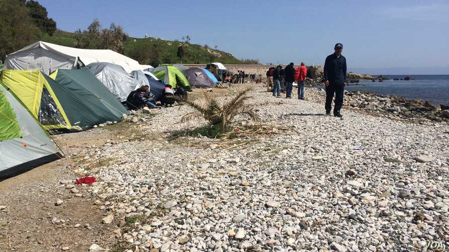 This beach camp in Lesbos, Greece, is expected to be cleared by authorities in the coming days. Some residents say they will not go to the main camp, where they will be locked inside, April 4, 2016. (H. Murdock/VOA)