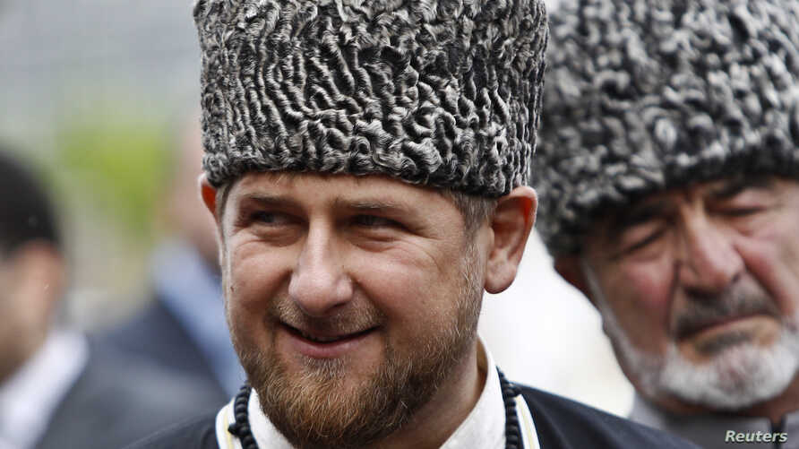 FILE - Chechen leader Ramzan Kadyrov smiles during a government-organized event marking Chechen language day in central Grozny, April 25, 2013.