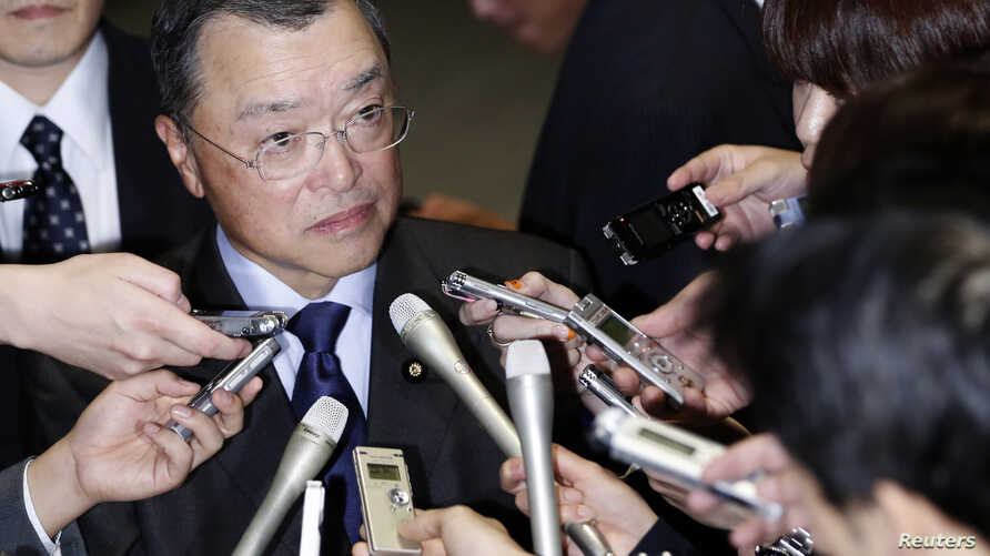 Japan's newly-appointed Economy, Trade and Industry Minister Yoichi Miyazawa speaks to the media after visiting Japan's Prime Minister Shinzo Abe at his official residence in Tokyo, October 20, 2014.