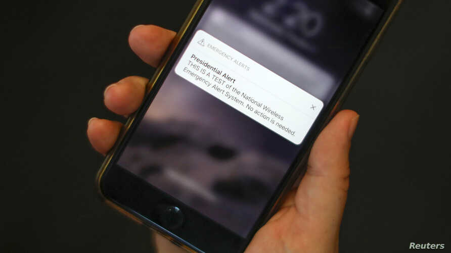A test text message of the Presidential Alert, National Wireless Emergency Alert System is seen on a mobile phone in New York City, New York, Oct. 3, 2018.