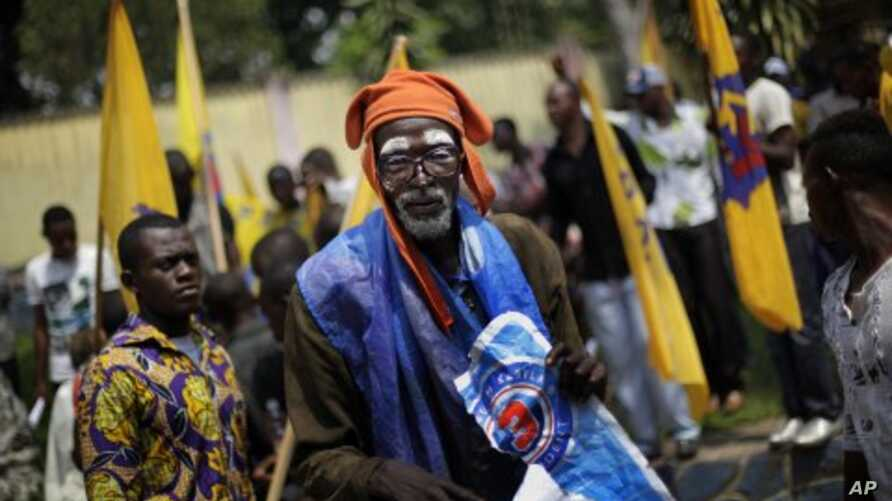 A supporter of President Joseph Kabila stands at his party's headquarters in Kinshasa, Democratic Republic of Congo, December 1, 2011.