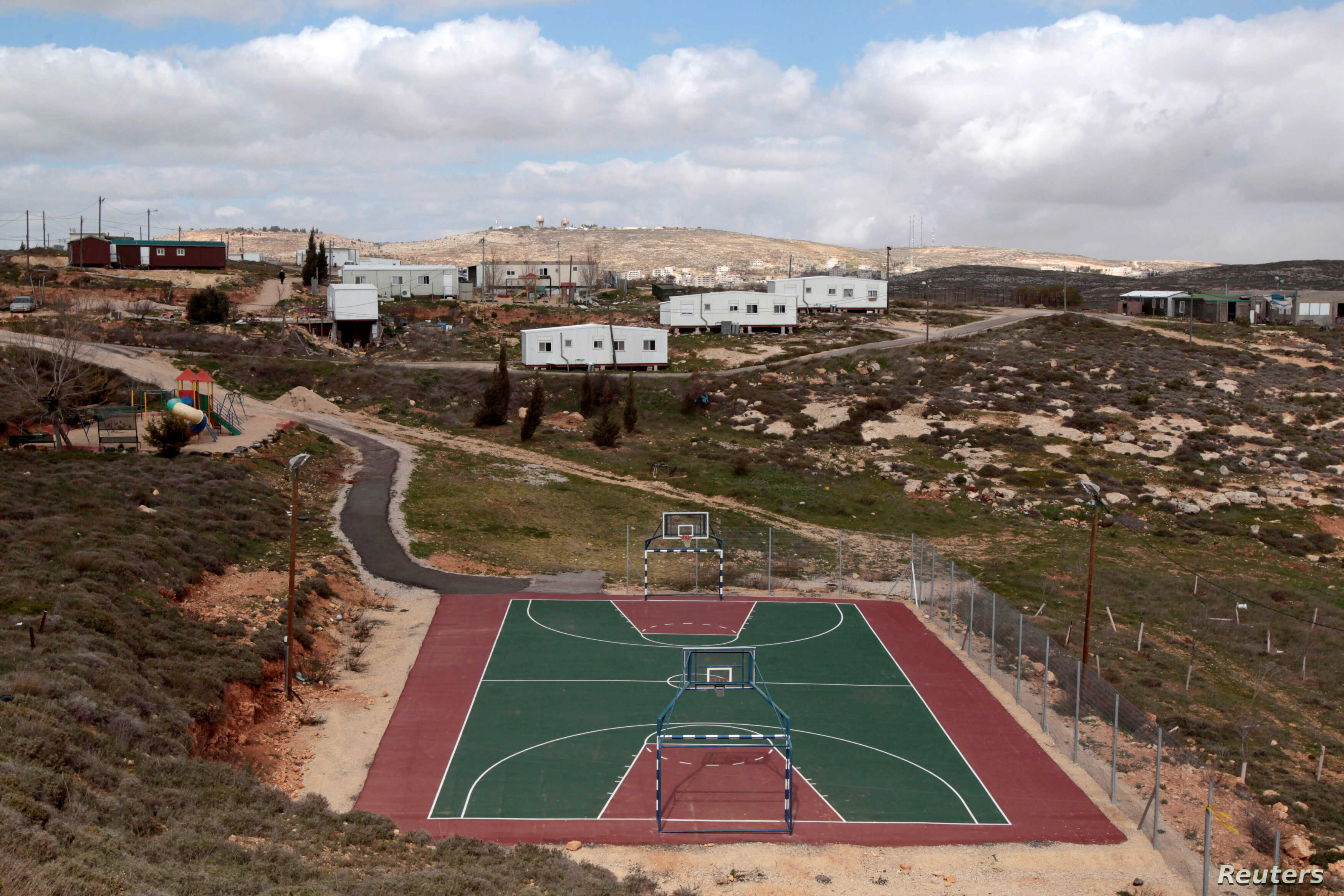 FILE - A basketball court is seen in the settler outpost of Amona near the Jewish settlement of Ofra, north of Ramallah, March 1, 2011.