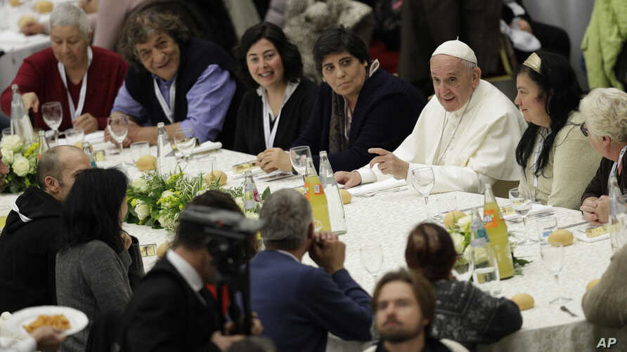 Pope Francis entertains his hosts during a lunch at the Vatican, Nov. 19, 2017.