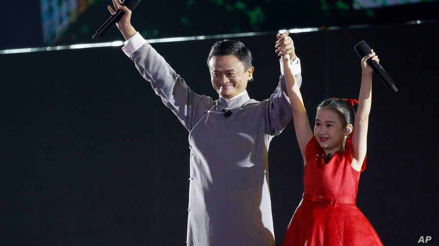 FILE - Jack Ma executive chairman of Alibaba Group gestures to the audience during the closing ceremony for the 18th Asian Games in Jakarta, Indonesia, Sunday, Sept. 2, 2018.