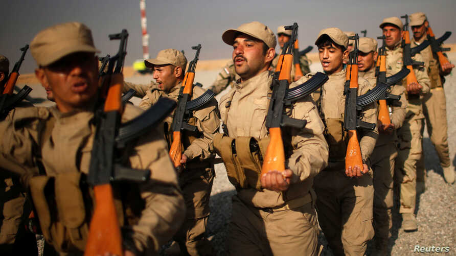 FILE - Iraqi fighters from Hashid Shaabi take part in a training at Makhmur camp in Iraq, Dec. 11, 2016.