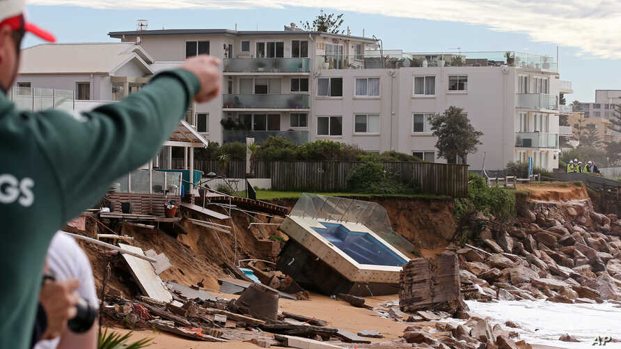 A swimming pool is dislodged and lays on a beach after storms undermined the pilings at Collaroy in Sydney, Monday, June 6, 2016.