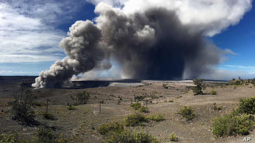 This photo from the U.S. Geological Survey shows activity at Halema'uma'u Crater that has increased to include the nearly continuous emission of ash with intermittent stronger pulses at Hawaii Volcanoes National Park on the island of Hawaii at around