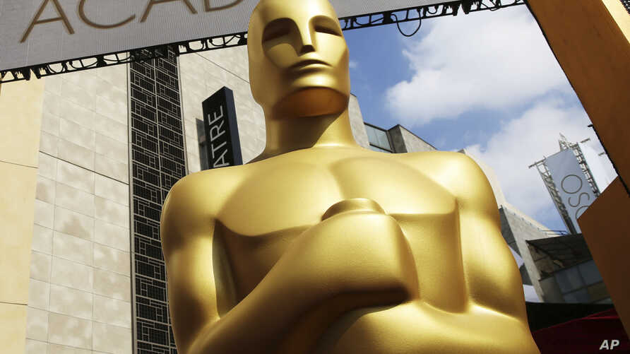 FILE - An Oscar statue appears outside the Dolby Theatre for the 87th Academy Awards in Los Angeles. The Academy of Motion Picture Arts and Sciences is trying to open access to the entertainment business for people from underrepresented communities.