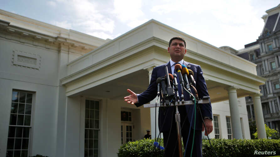 Ukraine's Prime Minister Volodymyr Groysman talks to members of the media after a meeting with U.S. Vice President Joe Biden, at the White House in Washington U.S., June 15, 2016.