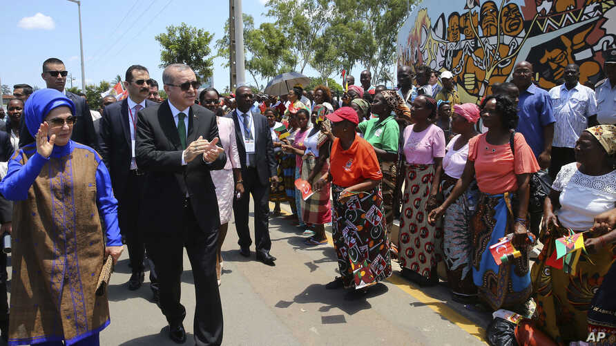 Turkey's President Recep Tayyip Erdogan and his wife, Emine Erdogan, greet local people during a ceremony in Maputo, Mozambique, Jan. 24, 2017. Erdogan has arrived in Mozambique on an Africa tour in which he is promoting trade and asking governments