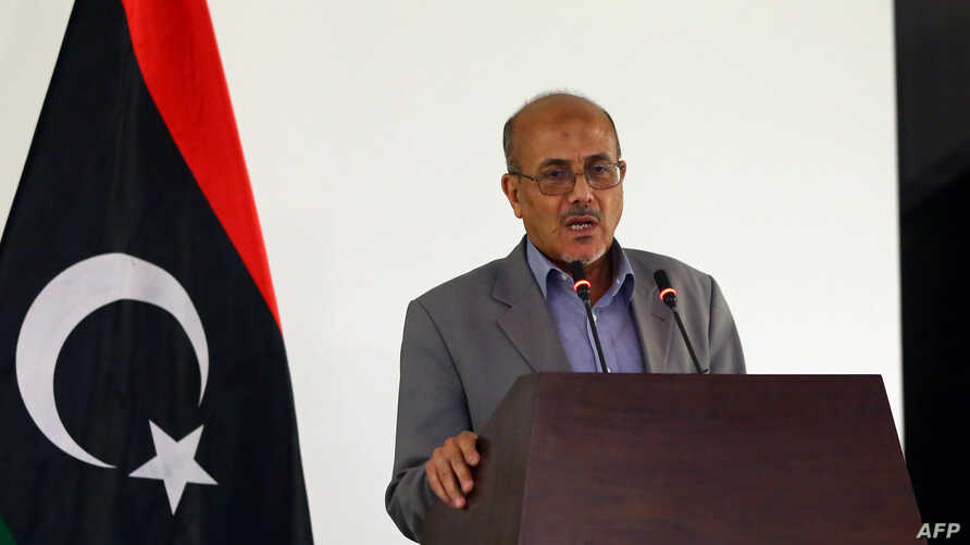 Libyan government's spokesman Ahmad Lamen holds a press conference in the capital as deadly clashes rage around the country's main international airport, in Tripoli, Libya, July 13, 2014.