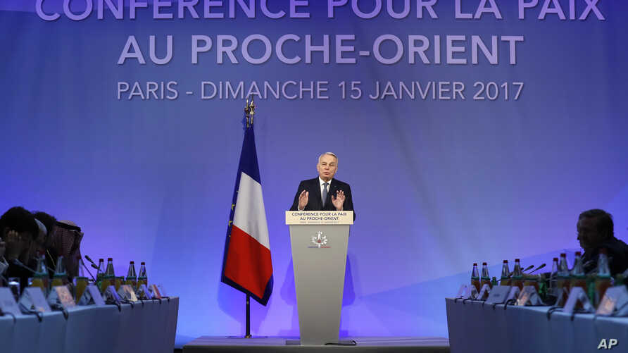 French Minister of Foreign Affairs Jean-Marc Ayrault addresses delegates at the opening of the Mideast peace conference in Paris, Jan. 15, 2017.