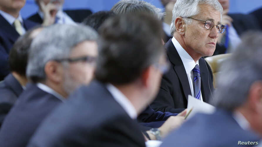 U.S. Defense Secretary Chuck Hagel (R) is seen at a NATO defense ministers meeting at the alliance's headquarters in Brussels October 22, 2013.