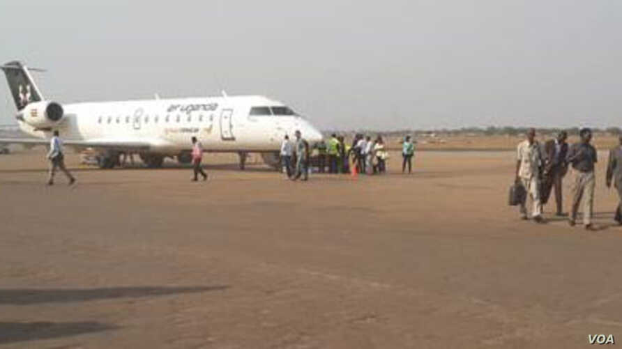 Passengers disembark and walk to the terminal at Juba International Airport, which is to undergo an overhaul, funded by China's Export and Import Bank.