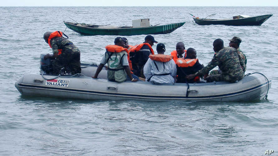 FILE - Cameroonian coast guards and marines are seen in a rescue boat near the port town of Kribi, Cameroon, March 26, 2006.