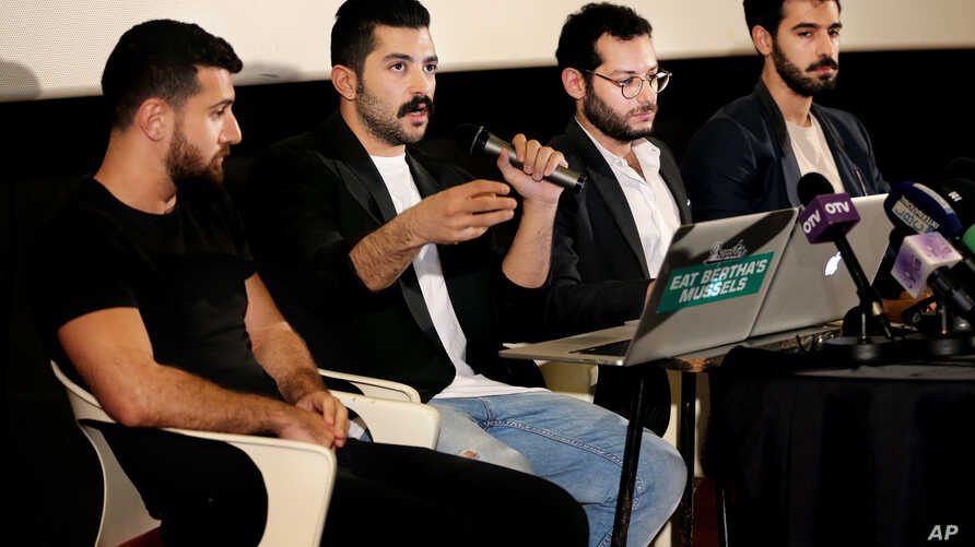"""Lebanese Hamed Sinno, second left, lead singer and song writer of the Lebanese group Mashrou' Leila or """"Leila's Project"""" band, speaks during a press conference with his band musicians, in Beirut, Lebanon, Thursday, April 28, 2016."""