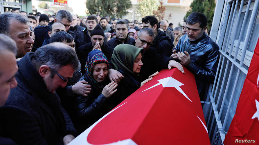 Relatives of Fatih Cakmak, a security guard and a victim of an attack by a gunman at the Reina nightclub, attend his funeral in Istanbul, Turkey, Jan. 2, 2017.