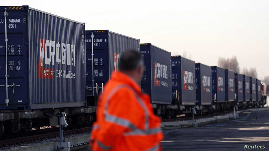 A worker looks at the first freight train to travel from China to Britain during a welcoming ceremony to mark the inaugural trip at at Barking Intermodal Terminal near London, Jan. 18, 2017.