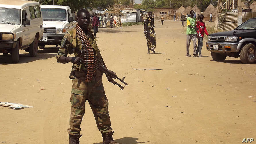 A soldier from South Sudan's army stands guard in Malakal in the Upper Nile State of South Sudan, Dec. 31, 2013.