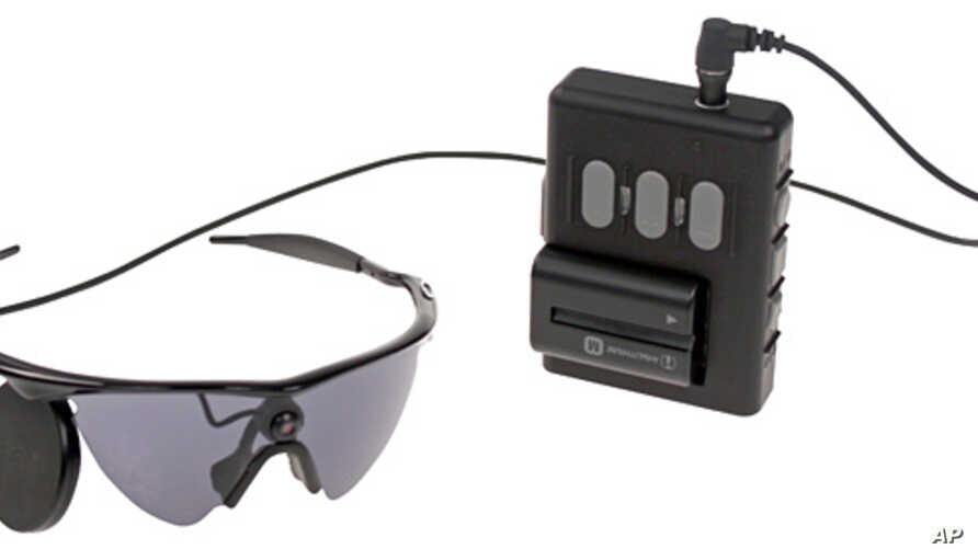 This undated product image provided by Second Sight Medical Products shows a  small video camera and transmitter mounted on a pair of glasses. Images from the camera are processed into electronic data that is wirelessly transmitted to electrodes impl