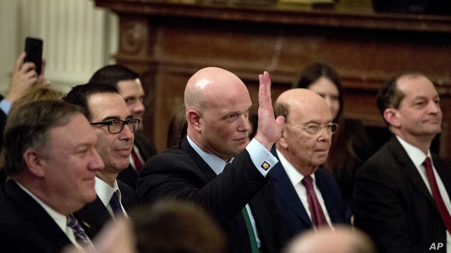 Acting United States Attorney General Matt Whitaker waves as he is recognized by President Donald Trump during a Medal of Freedom ceremony in the East Room of the White House in Washington, Nov. 16, 2018.