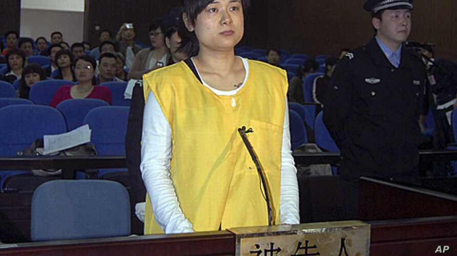 Wu Ying, head of the Bense Holding Group, stands on trial for allegedly raising over 390 million yuan by promising high returns to her creditors at the intermediate people's court in Jinhua in eastern China's Zhejiang province, (File April 16, 2009).