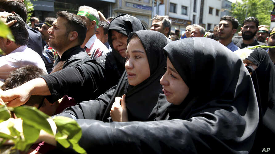Iranians attend the funeral of victims of an Islamic State militant attack, in Tehran, Iran, June 9, 2017. Attacks this week, claimed by Islamic State, killed 17 people.