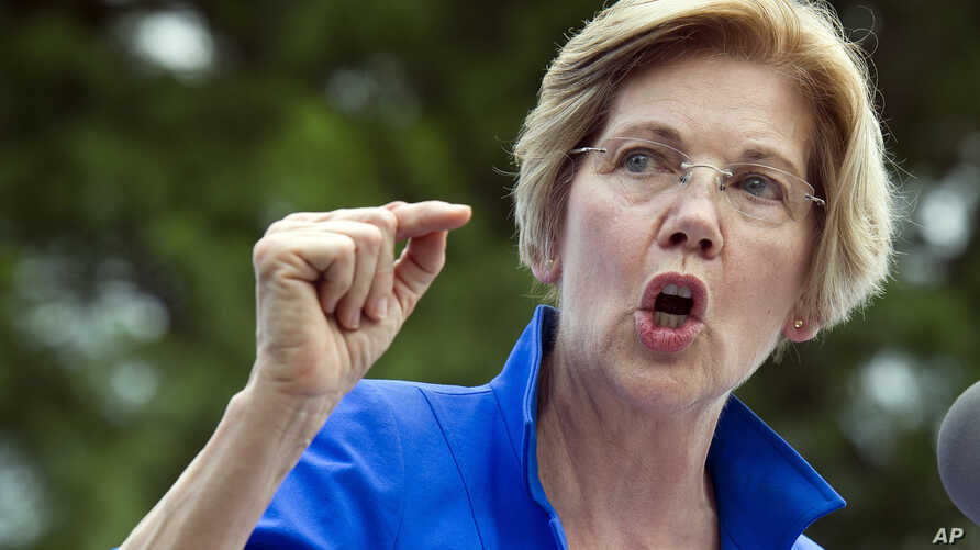 Sen. Elizabeth Warren, D-Mass., speaks in a park in Berryville, Va., where Congressional Democrats unveiled their new agenda, July 24, 2017. Warren is working to defuse an issue that has dogged her for years, her claims of Native American heritage, a