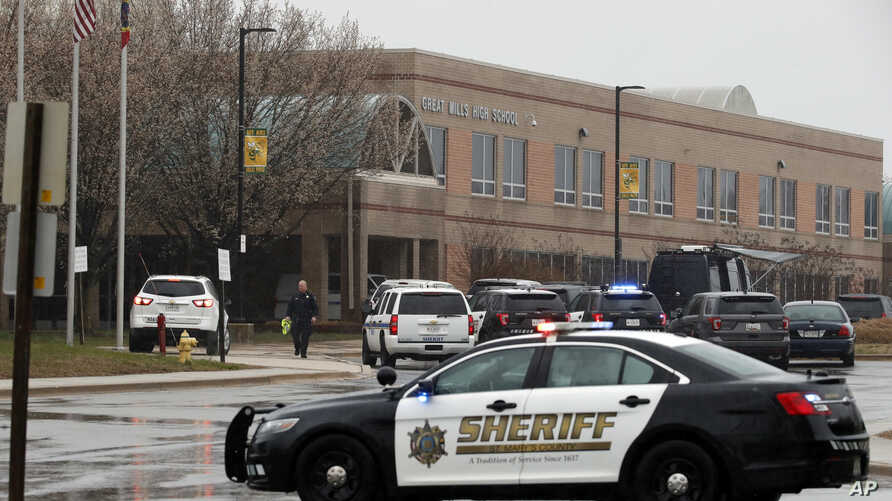 A law enforcement officer walks in front of Great Mills High School, the scene of a shooting, March 20, 2018, in Great Mills.