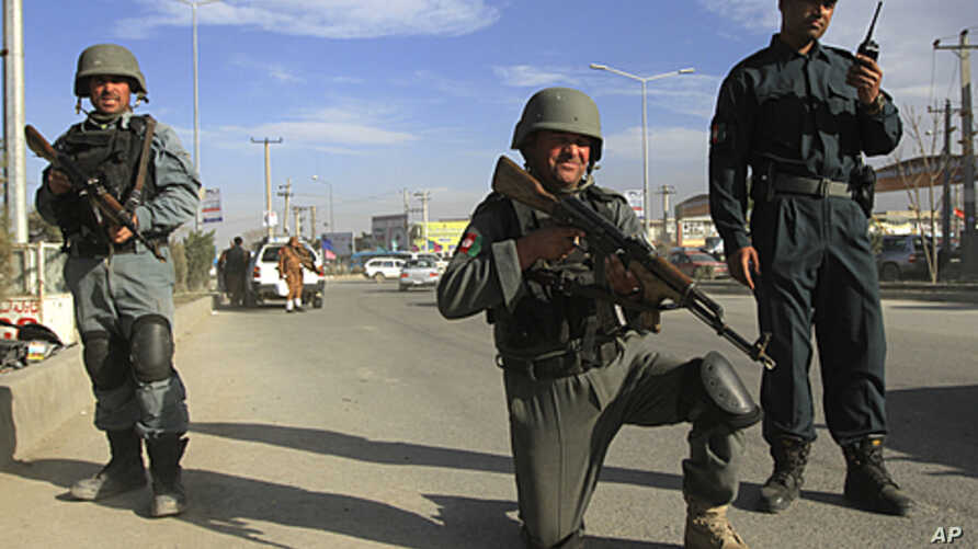 Afghan police keep watch at a checkpoint in Kabul, April 10, 2012.