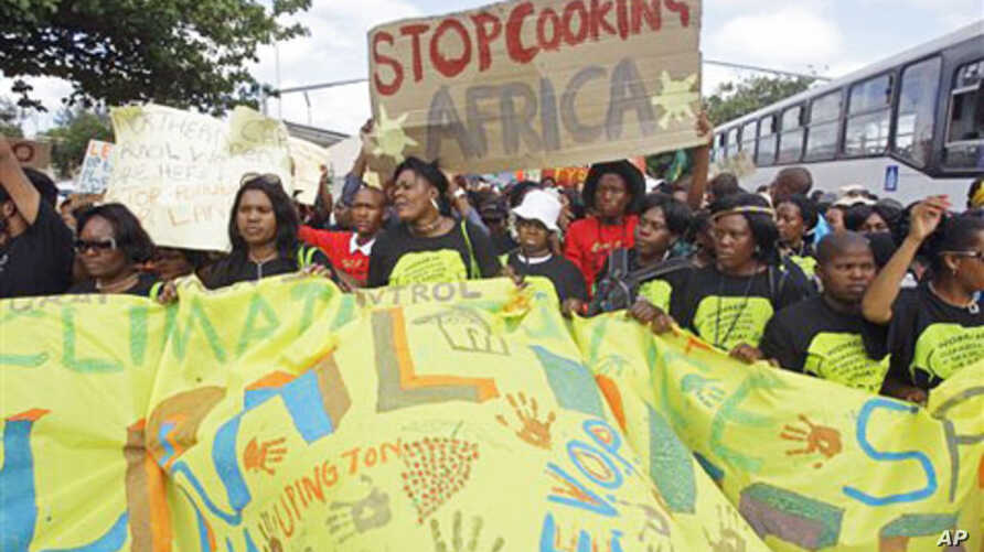 Protesters march during a climate change rally outside a climate change summit held in the city of Durban, South Africa, Friday, Dec 2, 2011. (AP Photo/Schalk van Zuydam)