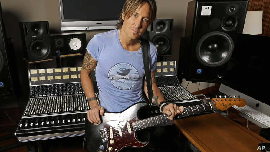 """FILE - In this April 14, 2016, file photo, Keith Urban poses in Nashville, Tenn., to promote his latest album, """"Ripcord."""" Urban leads nominations for the Academy of Country Music Awards with seven nominations as both artist and producer for his recor..."""