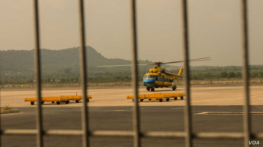 A helicopter takes off Tuesday from Vietnam's southwest Phu Quoc Island to search for the passengers of Malaysian Airlines flight MH370