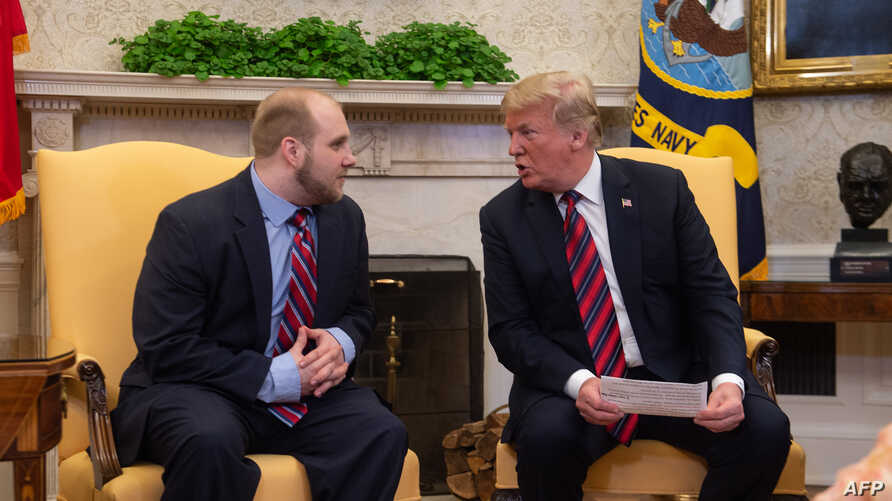 President Donald Trump speaks with Joshua Holt, who had been detained in Venezuela for two years, in the Oval Office at the White House in Washington, on May 26, 2018.