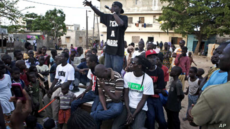 A member of the activist hip-hop group Y'en a marre performs during a community concert in the Dalifort neighborhood of Senegal's capital Dakar.  Using a mix of concerts, demonstrations and stomping the streets in black T-shirts emblazoned with their