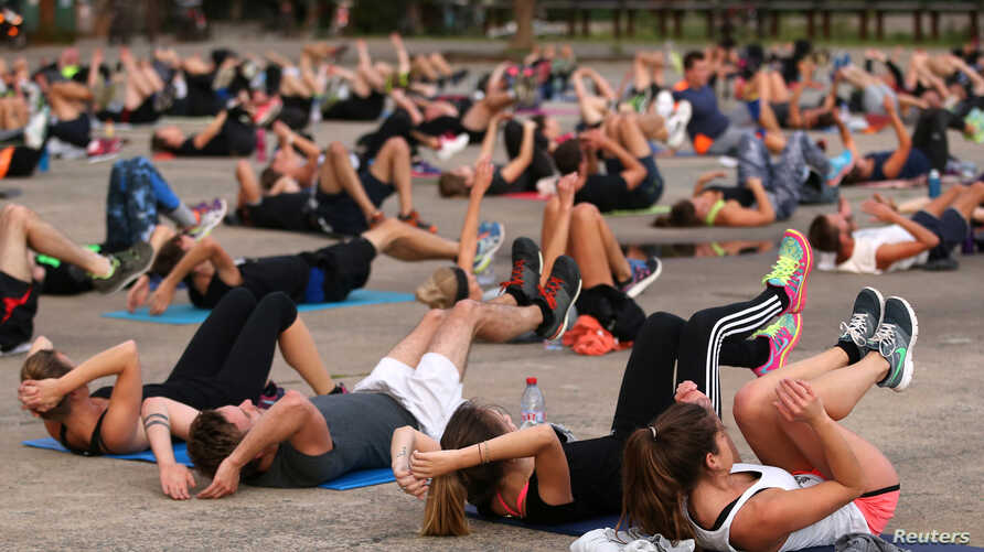FILE - People gather for physical exercise in Nantes, France, Sept. 18, 2017.