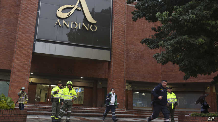 Police officers and safety personnel stand at the entrance of the Centro Andino shopping center after and explosion rocked the building, in Bogota, Colombia, June 17, 2017.