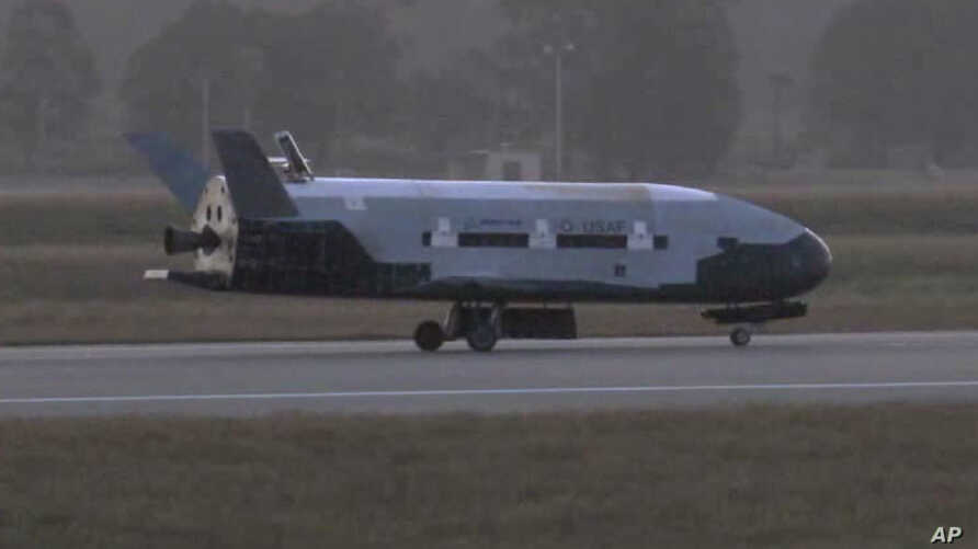 A June 16, 2012 image from video made available by Vandenberg Air Force Base shows the X-37B unmanned spacecraft landing at Vandenberg Air Force Base, California.