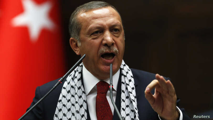 Turkey's Prime Minister Tayyip Erdogan addresses members of parliament from his ruling AK Party (AKP) during a meeting at the Turkish parliament in Ankara, July 22, 2014.